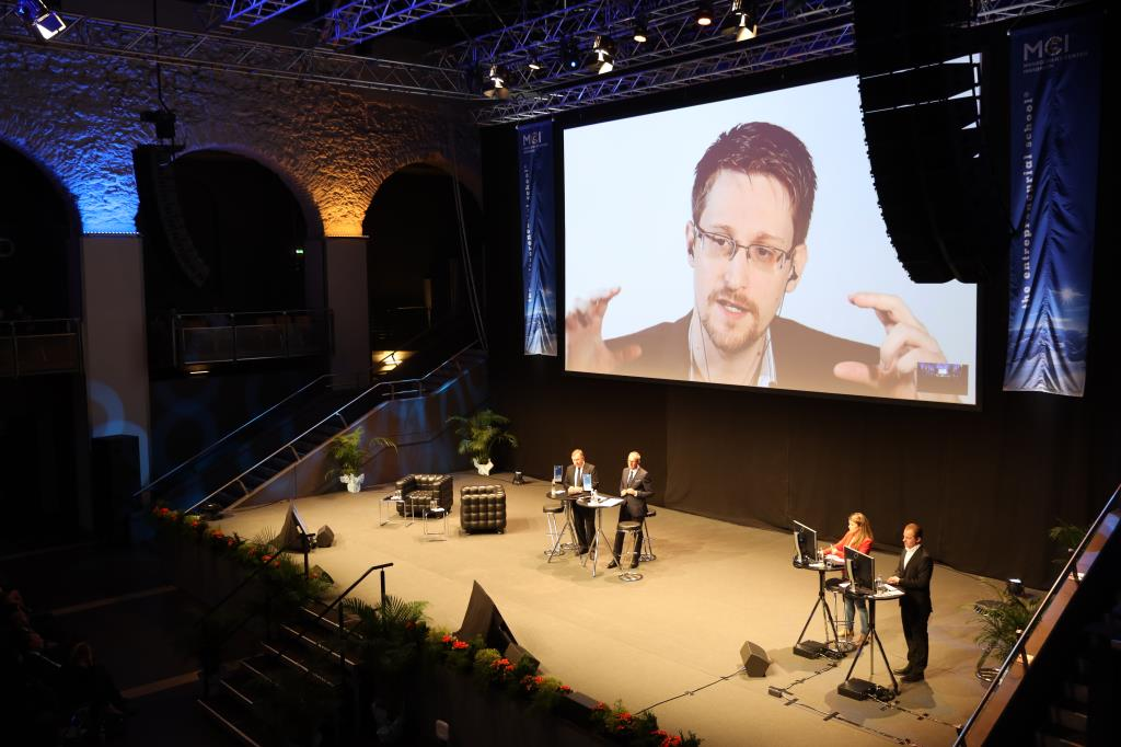 Snowden gesticulates heavily